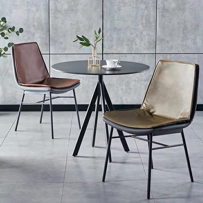 轻奢餐椅家用马鞍椅北欧靠背椅皮椅餐厅椅子网红酒店复古椅子凳子